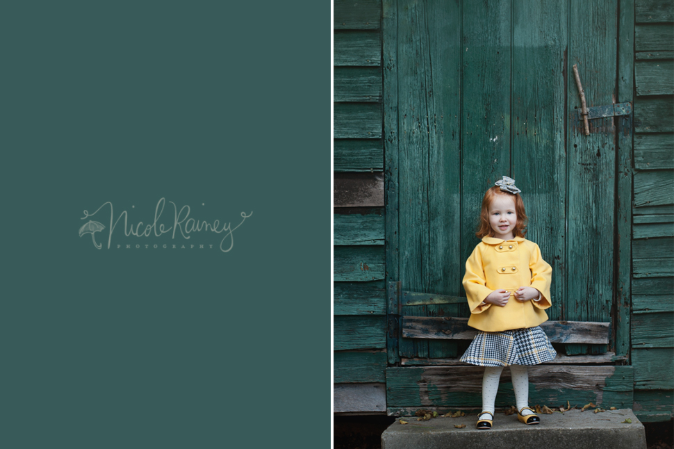 Red headed little girl in yellow jacket in front of teal wall